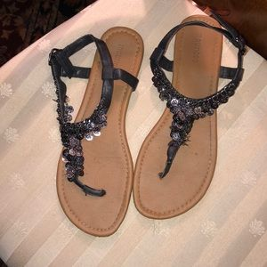Maurice's black coin adorned Sandals.